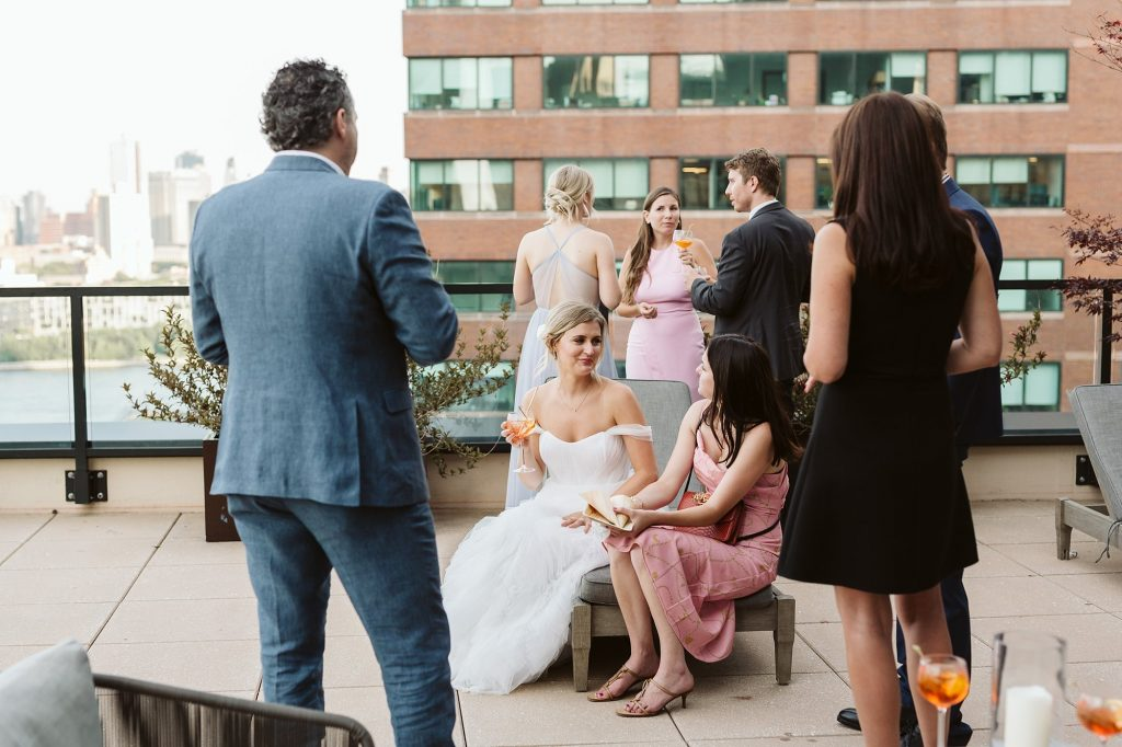 manhattan intimate wedding dinner rooftop photo by NYC elopement photographer Sarah Sayeed