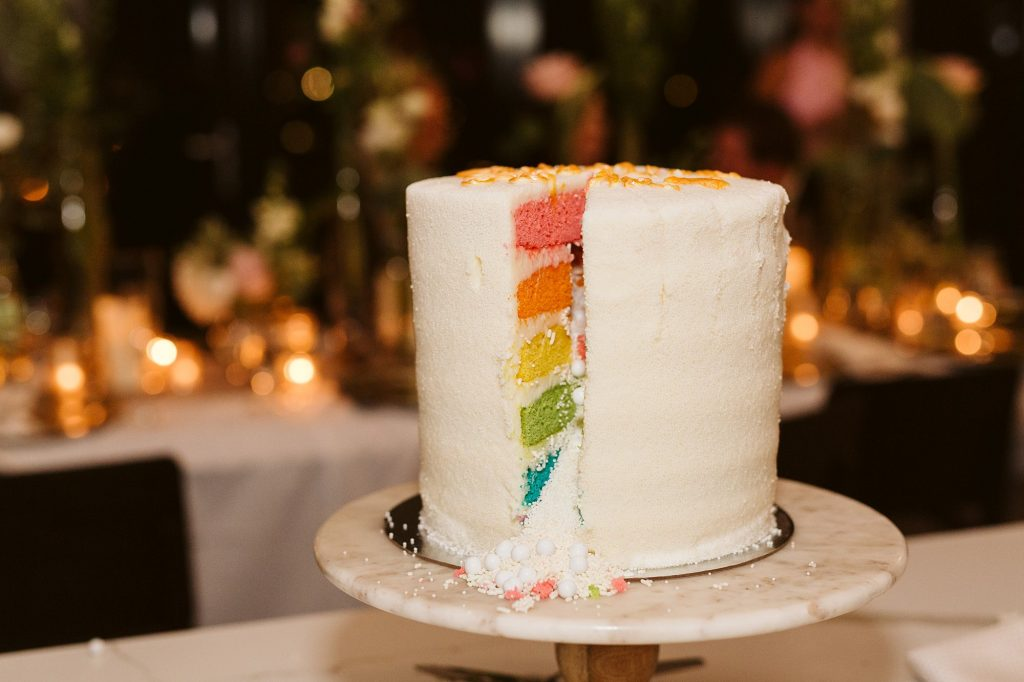 rainbow sprinkles wedding cake by flour shop by downtown manhattan intimate wedding dinner photos by NYC elopement photographer Sarah Sayeed